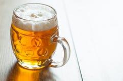 Czeski piwo w szkle na rocznika tle Zdjęcie Royalty Free