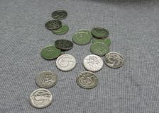 5 CZK coins over fabric surface. 5 CZK coins over grey ribbed cotton fabric surface Royalty Free Stock Image