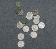 5 CZK coins over fabric surface. 5 CZK coins over grey ribbed cotton fabric surface Stock Photos