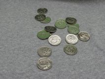 5 CZK coins over fabric surface. 5 CZK coins over grey ribbed cotton fabric surface Royalty Free Stock Photography