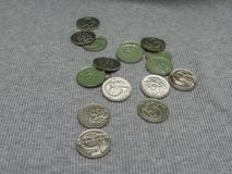 5 CZK coins over fabric surface. 5 CZK coins over grey ribbed cotton fabric surface Stock Photography