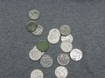 5 CZK coins over fabric surface. 5 CZK coins over grey ribbed cotton fabric surface Royalty Free Stock Photo