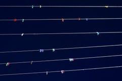 Czopy na sznurkach przeciw niebu Zdjęcie Royalty Free