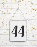 44 czterdzieści cztery lat rocznicowego przyjęcia urodzinowego congratulati obraz stock