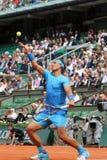 Czternaście czasu wielkiego szlema mistrzów Rafael Nadal podczas jego drugi round dopasowania przy Roland Garros 2015 Obraz Royalty Free