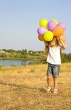 Czteroletnia dziewczyna z balonami Obrazy Royalty Free