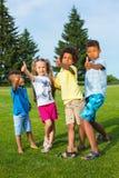 Cztery ładnego dzieciaka zdjęcie stock