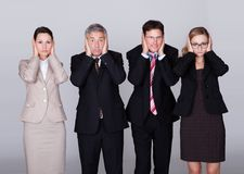 Cztery biznesmena trzyma ich ucho Obraz Royalty Free