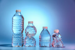 Cztery butelki woda Obraz Stock