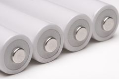 Cztery dwoisty baterie na biały tle. Obraz Stock