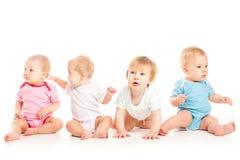 Cztery dziecka odizolowywającego Zdjęcia Stock