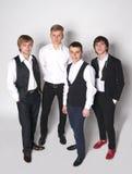 Cztery eleganckiego młodego człowieka Fotografia Stock