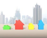 Cztery kolorowego domu na drewnianym stole Zdjęcie Stock