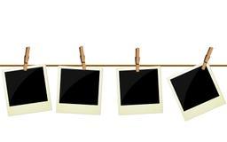 Cztery polaroidu obrazka wiesza na arkanie Zdjęcie Royalty Free