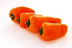 cztery pomarańczowego pieprzu Zdjęcie Stock