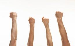 Cztery ręki pokazuje pięści Zdjęcie Royalty Free
