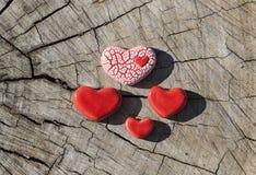 Cztery serca na drewnie Zdjęcie Royalty Free