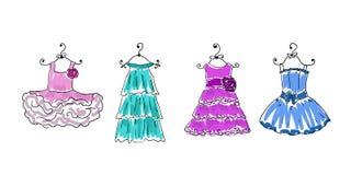 Cztery sukni na wieszakach Zdjęcie Royalty Free