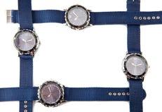 Cztery zegarka kłamstwa na białym tle tworzy ramę Obraz Royalty Free