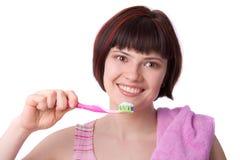czyścić ząb jej kobiety Zdjęcie Stock