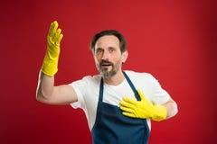 Czyści dzień dzisiaj Brodaty facet czyści do domu Na strażniku czystość i rozkaz Czyści usługi i gospodarstwa domowego obowiązek obrazy royalty free
