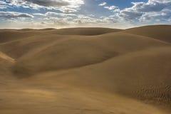 Barren desert landscape in the sunlight stock photography