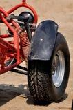 Däck av strandsandmotorcykeln royaltyfria foton