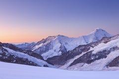 Dämmerung bei Jungfraujoch in der Schweiz Stockfotografie