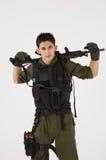 Dämpfungsregler-Soldat in der beiläufigen Haltung Stockfotos