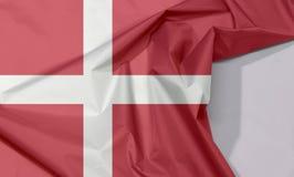Dänemark-Gewebeflaggenkrepp und -falte mit Leerraum lizenzfreie stockbilder