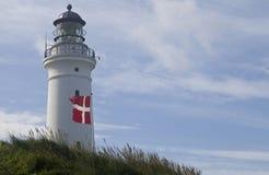 Dänische Flagge, dänischer Leuchtturm Lizenzfreie Stockbilder