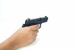 Dé a control la pistola automática aislada del fondo blanco Foto de archivo