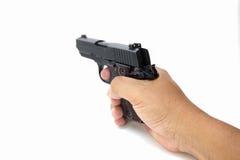 Dé a control la pistola automática aislada del fondo blanco Fotos de archivo