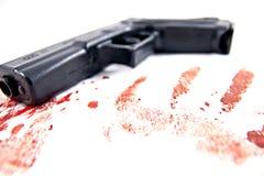 Dé el arma con sangre Imagen de archivo libre de regalías