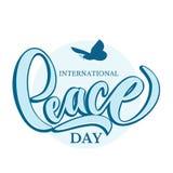 Dé el día internacional exhausto de cartel de las letras de la tipografía de la paz Fotos de archivo