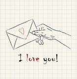 Dé la mano exhausta que sostiene un sobre precioso de la letra en el papel cuadrado matemático Fotografía de archivo