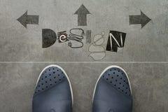 Dé la palabra exhausta de Design design en el frente del negocio Foto de archivo libre de regalías