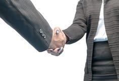 Dé la sacudida entre un hombre de negocios y una mujer de negocios Imagen de archivo