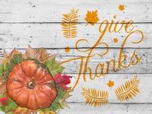 Dé las gracias con la calabaza y las hojas de otoño por día de la acción de gracias Foto de archivo libre de regalías