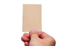 Dé las tarjetas de visita del control en la trayectoria de recortes blanca del fondo Fotografía de archivo libre de regalías