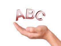 Dé llevar a cabo el símbolo de ABC de las letras en el fondo blanco Imagenes de archivo