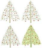Cuatro diversos árboles de navidad Imágenes de archivo libres de regalías