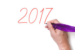 2017 Dé a números de la escritura la pluma púrpura en el fondo blanco Imagen de archivo