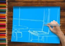 dé a oficina de dibujo las líneas blancas en el papel azul En un escritorio con los lápices Foto de archivo