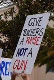 Dé a profesores un aumento no un arma Fotografía de archivo libre de regalías