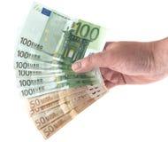 Dé sostener hacia fuera una fan del dinero del eurobill Foto de archivo libre de regalías