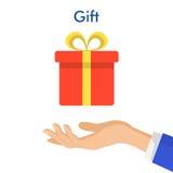 Dé sostener la caja de regalo roja con el arco amarillo Vector plano del estilo Fotos de archivo libres de regalías