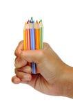 Dé sostener los lápices 2 del color fotos de archivo libres de regalías