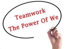 Dé a trabajo en equipo de la escritura el poder de nosotros en tablero transparente Imagenes de archivo