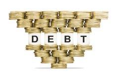 DÉBITO da palavra da gestão de dívidas na pilha instável de moedas de ouro Imagem de Stock